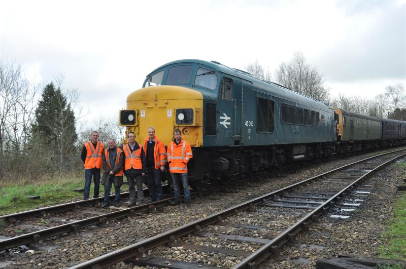 45060 'Sherwood Forester' with lucky owner Mike Jacob (centre), DR driver Keith Netherton (2nd left), and members of the Pioneer Diesels group who look after Sherwood so well. After a successful test drive, Keith has decided he'd like one, and is reaching for his chequebook.