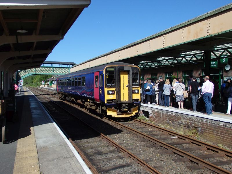 Crowds queueing to embark on 153377 for the first up train of the day.