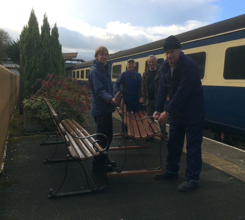 The DRSA team (from left) John Caesar, Tom Baxter, Tony Hill and Jon Kelsey unloading one of the new benches. Photo copyright Robin White of the West Somerset Railway Asssociation.