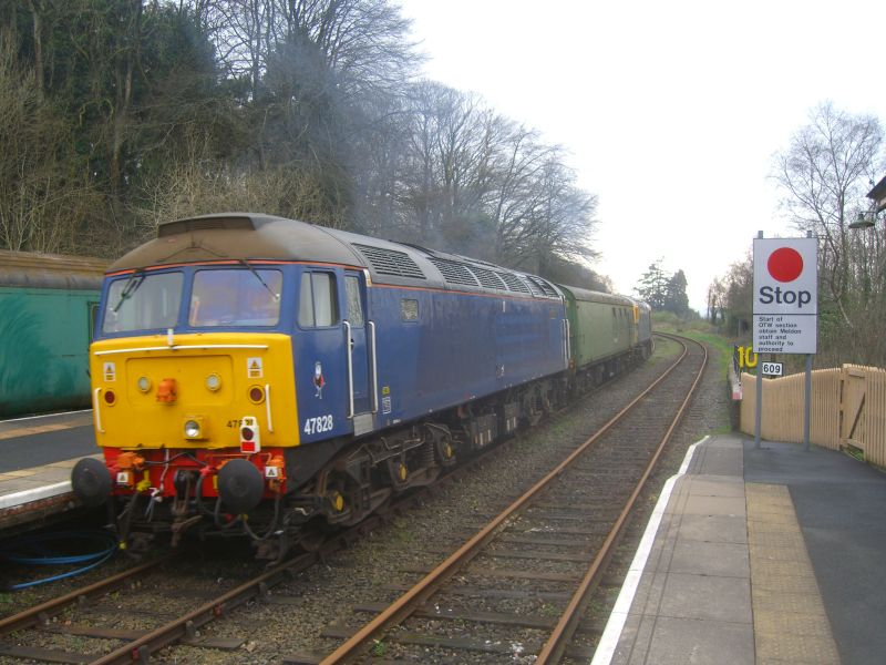 47828, DB 977335 (The Rocket) and 33035 arriving at Okehampton.