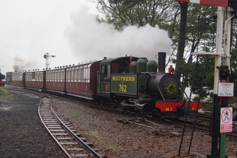 The world's newest steam engine at the rainy Lynton and Barnstaple steam gala. Replica Baldwin 2-4-2T no 762 'Lyn' at Woody Bay. Bagnall 'Isaac' is at the other end.