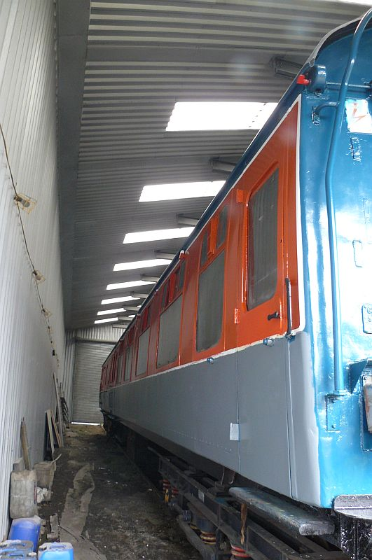 One side has been prepared and primered following the graffiti attack, and is ready for its top coats of rail blue.